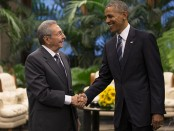 Cuban President Raul Castro, left, shakes hands with U.S. President Barack Obama during a meeting in Revolution Palace, Monday, March 21, 2016. Brushing past profound differences, President  Obama and President Castro sat down for a historic meeting, offering critical clues about whether Obama's sharp U-turn in policy will be fully reciprocated. (Ismael Francisco/ Cubadebate via AP)